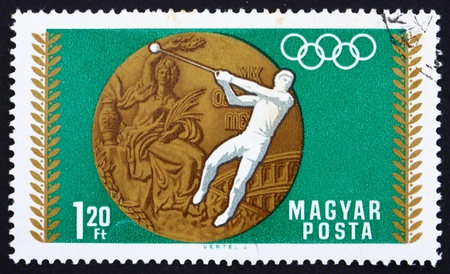 HUNGARY - CIRCA 1969: a stamp printed in the Hungary shows Hammer Throwing, Summer Olympic sports, Mexico 68, circa 1969