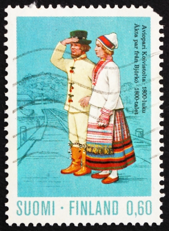 FINLAND - CIRCA 1972: a stamp printed in the Finland shows Married Couple from Koivisto, 19th Century, Regional Costume, circa 1972 Stock Photo - 14224085
