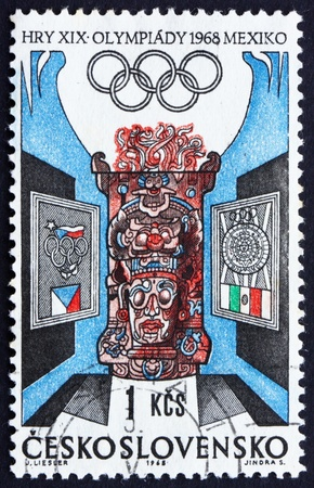 czechoslovak: CZECHOSLOVAKIA - CIRCA 1968: a stamp printed in the Czechoslovakia shows Czechoslovak and Mexican Olympic Emblems and Carved Altar, Summer Olympic sports, Mexico 68, circa 1968