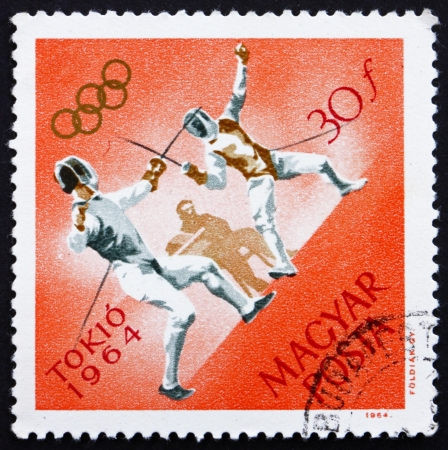 HUNGARY - CIRCA 1964: a stamp printed in the Hungary shows Fencing, Summer Olympic sports, Tokyo 64, circa 1964 Stock Photo - 14224096