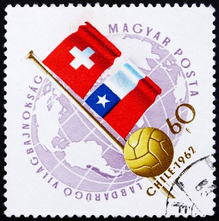 HUNGARY - CIRCA 1962: a stamp printed in the Hungary shows Globe, Ball and Flags of Switzerland and Chile, World Cup Soccer Championship, Chile, circa 1962 Stock Photo - 14224087