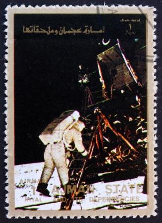 AJMAN - CIRCA 1973: a stamp printed in the Ajman shows Edwin Buzz Aldrin Stepping out of the Eagle, Moon-landing, Apollo 11, circa 1973