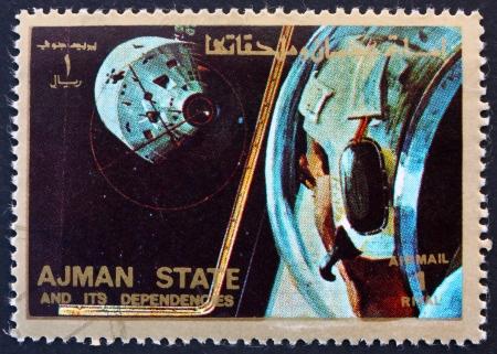 docking: AJMAN - CIRCA 1973: a stamp printed in the Ajman shows Docking Maneuver, Space Exploration Program, Apollo, circa 1973 Editorial