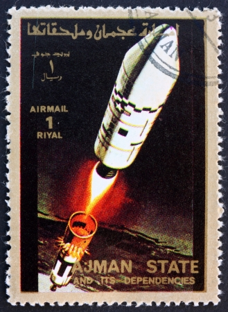 spaceflight: AJMAN - CIRCA 1973: a stamp printed in the Ajman shows Rocket in Space, Spaceflight Program, circa 1973 Editorial