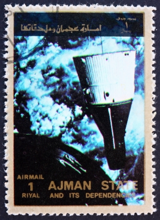 AJMAN - CIRCA 1973: a stamp printed in the Ajman shows Rendezvous of Gemini 6 and 7, Space Exploration Program, circa 1973