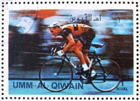UMM AL-QUWAIN - CIRCA 1972: a stamp printed in the Umm al-Quwain shows Cycling, Olympic Sport, Olympic Games of the past, circa 1972
