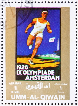 UMM AL-QUWAIN - CIRCA 1972: a stamp printed in the Umm al-Quwain shows Amsterdam 1928, Netherlands, Olympic Games of the past, circa 1972 Stock Photo - 14335317
