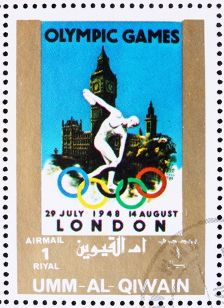 UMM AL-QUWAIN - CIRCA 1972: a stamp printed in the Umm al-Quwain shows London 1948, Great Britain, Olympic Games of the past, circa 1972