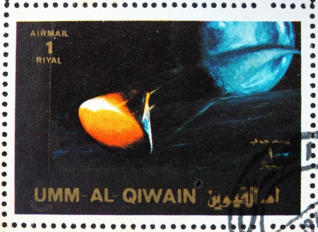 spaceflight: UMM AL-QUWAIN - CIRCA 1972: a stamp printed in the Umm al-Quwain shows Space Capsule Recovery, Apollo, Spaceflight Program, circa 1972 Editorial