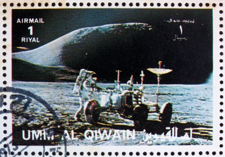 roving: UMM AL-QUWAIN - CIRCA 1972: a stamp printed in the Umm al-Quwain shows Astronaut James Irwin works on the Lunar Roving Vehicle, Moon-landing, Apollo 15, circa 1972