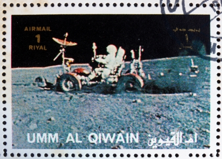 UMM AL-QUWAIN - CIRCA 1972: a stamp printed in the Umm al-Quwain shows Astronaut Driving a Moon Rover, Moon-landing, Apollo, circa 1972