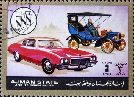 then: AJMAN - CIRCA 1972: a stamp printed in the Ajman shows Chevrolet, Cars Then and Now, circa 1972