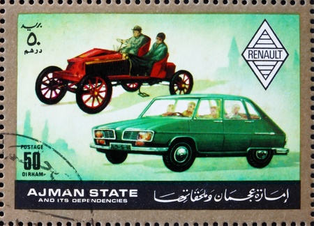 then: AJMAN - CIRCA 1972: a stamp printed in the Ajman shows Renault, Cars Then and Now, circa 1972