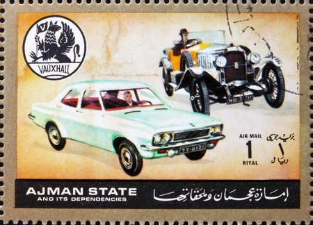 ajman: AJMAN - CIRCA 1972: a stamp printed in the Ajman shows Vauxhall, Cars Then and Now, circa 1972