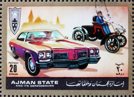 ajman: AJMAN - CIRCA 1972: a stamp printed in the Ajman shows Ford, Cars Then and Now, circa 1972