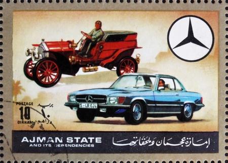 dann: AJMAN - CIRCA 1972: Stempel im Ajman gedruckt zeigt Mercedes, Autos damals und heute, circa 1972