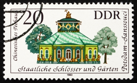 GDR - CIRCA 1983: a stamp printed in GDR shows Chinese Teahouse, Sanssouci, Summer Palace of Frederick the Great, King of Prussia, Potsdam Gardens, Germany, circa 1983