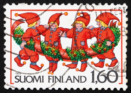FINLAND - CIRCA 1986: a stamp printed in the Finland shows Elves, Christmas, circa 1986