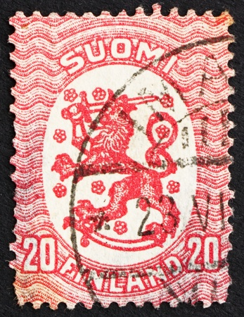 rampant: FINLAND - CIRCA 1920: a stamp printed in the Finland shows Crowned Lion Rampant, Arms of the Republic of Finland, circa 1920 Editorial