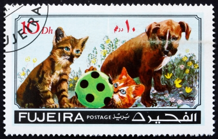fujeira: FUJEIRA - CIRCA 1971: a stamp printed in the Fujeira shows Dog and Cat, Pets, circa 1971