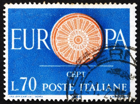 european integration: ITALY - CIRCA 1960: a stamp printed in the Italy shows 19-Spoke wheel, First Anniversary of the CEPT, 19 Founding Members of the Conference, European Integration, circa 1960