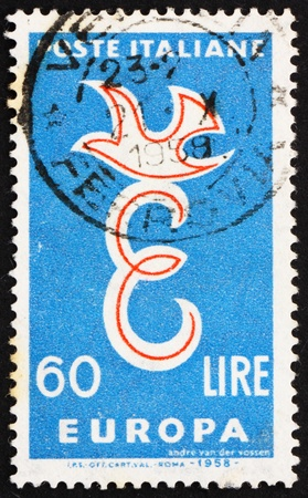european integration: ITALY - CIRCA 1958: a stamp printed in the Italy shows E and Dove, European Integration, circa 1958 Editorial