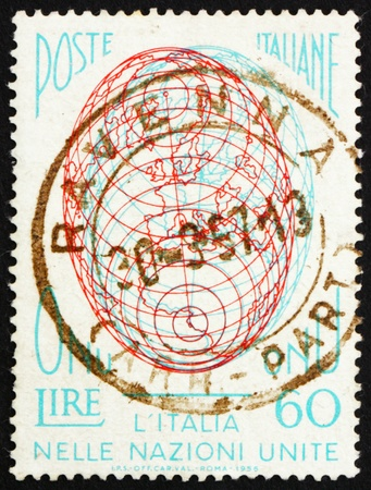un used: ITALY - CIRCA 1956: a stamp printed in the Italy shows Globe, Italy�s admission to the United Nations, circa 1956 Editorial
