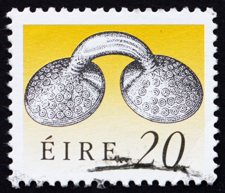 IRELAND - CIRCA 1991: a stamp printed in the Ireland shows Gold Dress Fastener, Art Treasure of Ireland, circa 1991