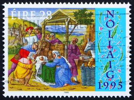 irish christmas: IRELAND - CIRCA 1995: a stamp printed in the Ireland shows Adoration of the Shepherds, Christmas, circa 1995 Editorial