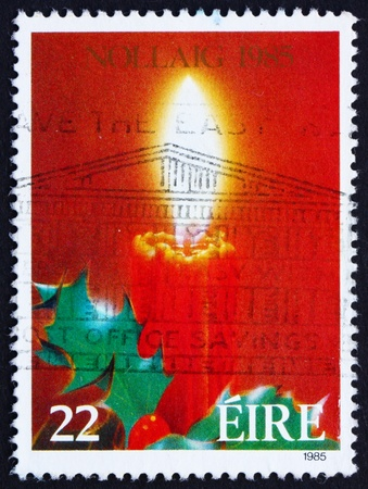 IRELAND - CIRCA 1985: a stamp printed in the Ireland shows Candle and Holy, Christmas, circa 1985