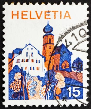 helvetia: SWITZERLAND - CIRCA 1973: a stamp printed in the Switzerland shows Village in Central Switzerland, circa 1973