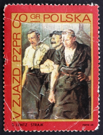 POLAND - CIRCA 1968: a stamp printed in the Poland shows Strikers, Painting by Stanislaw Lentz, circa 1968 Stock Photo - 14406616