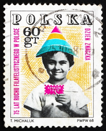philately: POLAND - CIRCA 1968: a stamp printed in the Poland shows Child Holding Symbolic Stamp, 75 Year of Polish Philately, circa 1968