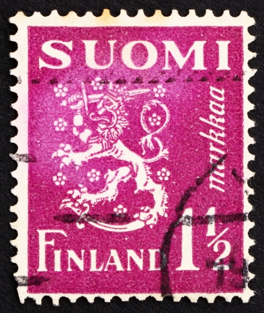 rampant: FINLAND - CIRCA 1930: a stamp printed in the Finland shows Crowned Lion Rampant, Arms of the Republic of Finland, circa 1930 Editorial