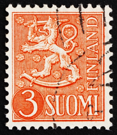 rampant: FINLAND - CIRCA 1954: a stamp printed in the Finland shows Crowned Lion Rampant, Arms of the Republic of Finland, circa 1954 Editorial