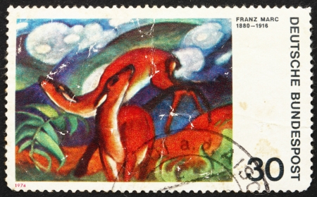 GERMANY - CIRCA 1974: a stamp printed in the Germany shows Deer in Red, Painting by Franz Marc, German Expressionist Painter, circa 1974 Stock Photo - 14514383