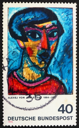 expressionist: GERMANY - CIRCA 1974: a stamp printed in the Germany shows Portrait in Blue, Painting by Alexej von Jawlensky, German Expressionist Painter, circa 1974