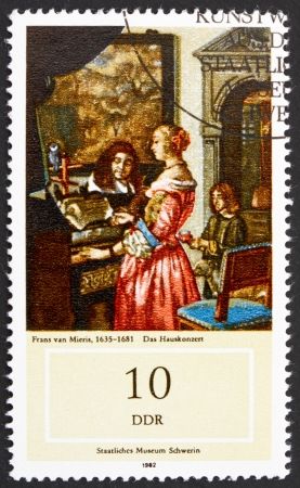 frans: GDR - CIRCA 1982: a stamp printed in GDR shows Music Making at Home, Painting by Frans van Mieris, circa 1982 Editorial