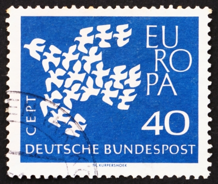 european integration: GERMANY - CIRCA 1961: a stamp printed in the Germany shows 19 Doves Flying as One, European Integration, circa 1961