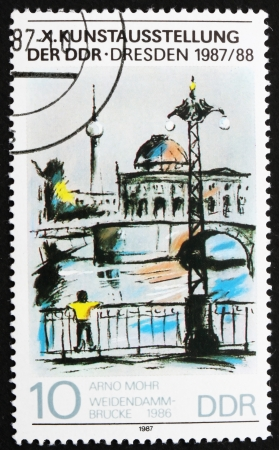 GDR - CIRCA 1987: a stamp printed in GDR shows Painting of Weidendamm Bridge by Arno Mohr, Berlin 1986, circa 1987