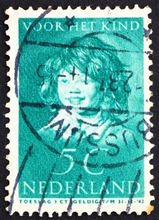 frans: NETHERLANDS - CIRCA 1937: a stamp printed in the Netherlands shows The Laughing Child, Painting by Frans Hals, circa 1937 Editorial