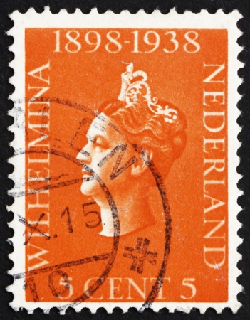 wilhelmina: NETHERLANDS - CIRCA 1939: a stamp printed in the Netherlands shows Queen Wilhelmina, 40th Anniversary of the Assumption as Monarch of the Netherlands, circa 1939 Editorial