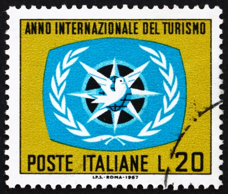ITALY - CIRCA 1967: a stamp printed in the Italy shows ITY Emblem, Intenational Tourist Year, circa 1967