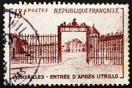FRANCE - CIRCA 1952: a stamp printed in the France shows Versailles Gate, Painted by Utrillo, France, circa 1952 Stock Photo - 14541799