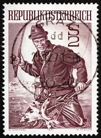 AUSTRIA - CIRCA 1971: a stamp printed in the Austria shows Trout Fisherman, circa 1971 Stock Photo - 14542821