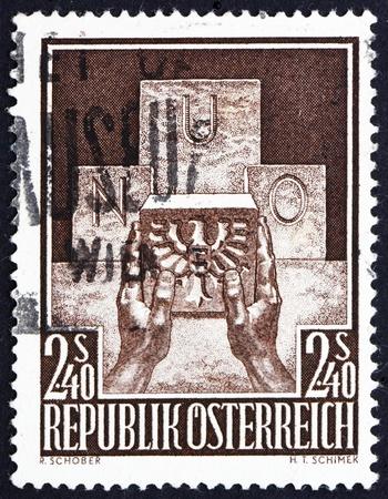 un used: AUSTRIA - CIRCA 1956: a stamp printed in the Austria shows Symbolic of Austrias Admission to the UN, circa 1956 Editorial