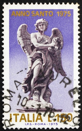 ITALY - CIRCA 1975: a stamp printed in the Italy shows Angel holding Crown of of Thorns, Statue by Giovanni Bernini on the Angels Bridge, San Angelo, circa 1975