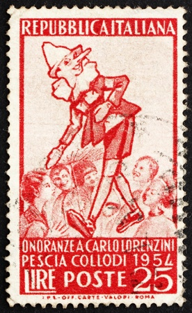 ITALY - CIRCA 1954: a stamp printed in the Italy shows Pinocchio and Group of Children, Carlo Lorenzini, Creator of Pinocchio, circa 1954