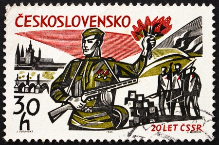 guerrilla: CZECHOSLOVAKIA - CIRCA 1965: a stamp printed in the Czechoslovakia shows Russian Soldier, View of Prague and Guerrilla Fighters, 20th Anniversary of Liberation from the Nazis, circa 1965
