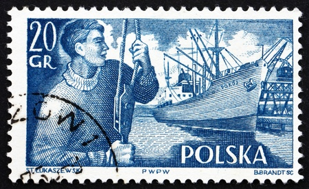 POLAND - CIRCA 1956: a stamp printed in the Poland shows Dock Worker and S. S. Pokoj, circa 1956